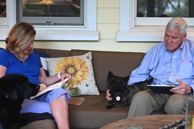 Dr. David Cole and Kathy Cole practicing social distancing with their two dogs