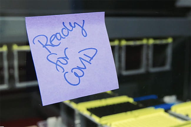 Image of a sticky note that reads. Ready for COVID