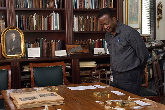 Image of a gentleman viewing items during tour of Waring Library