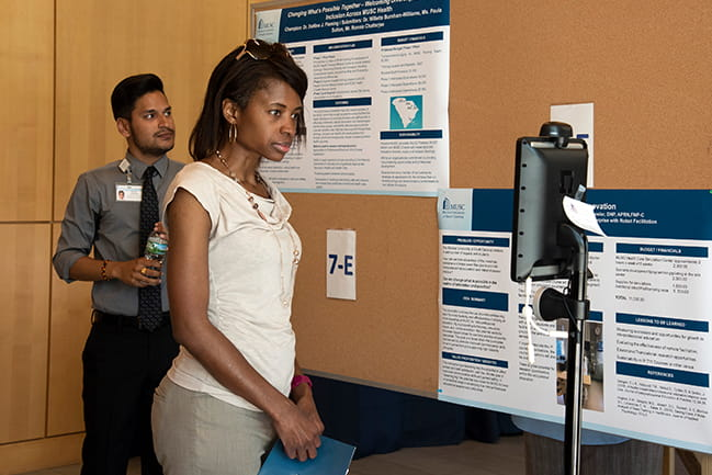 Image of a participant interacting with a robotic teaching device