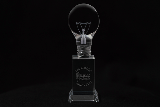 Crystal lightbulb engraved with the words I am a MUSC Innovator and the MUSC logo.