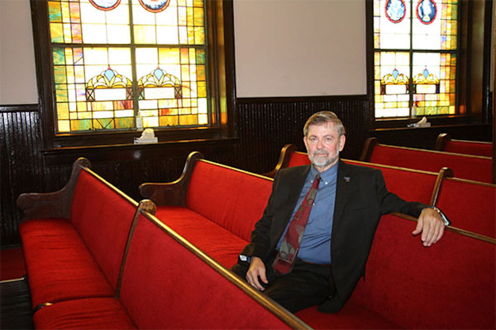 Dr. Dean Kilpatrick sitting on a pew in Mother Emauel Church