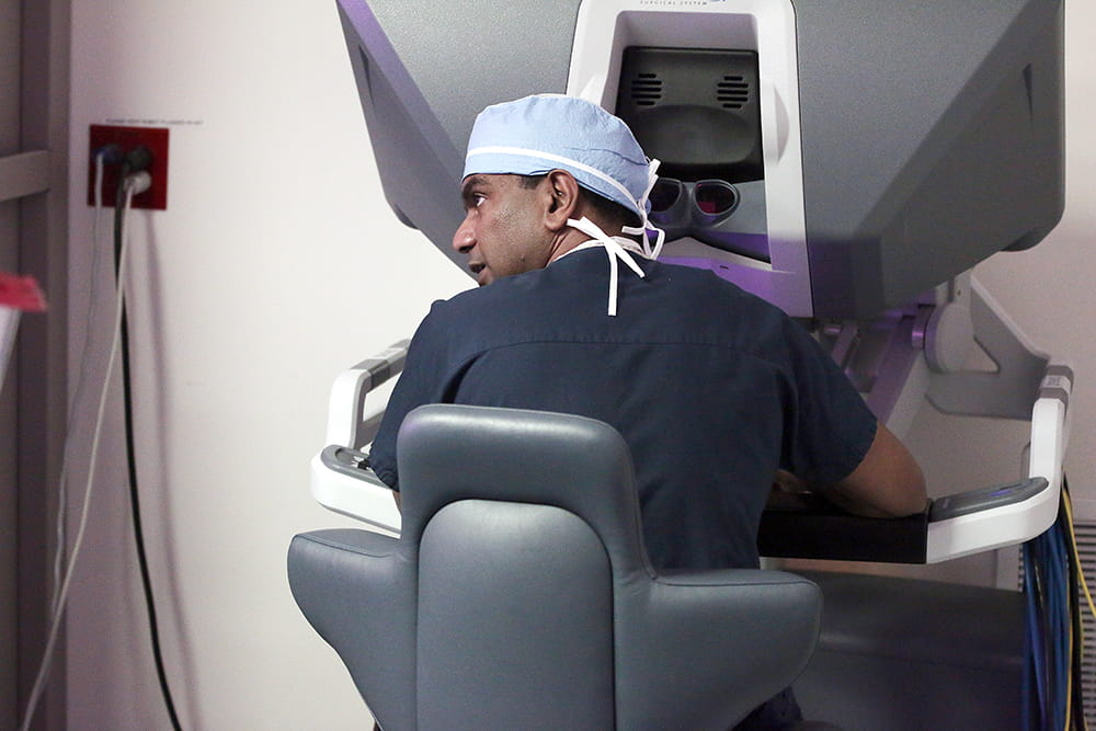 A doctor uses a robotic surgery instrument