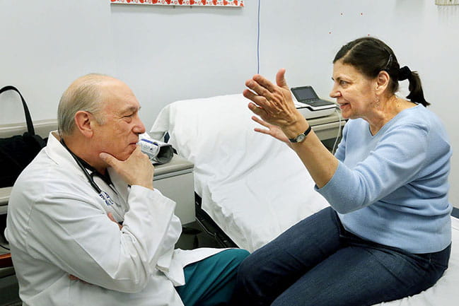 Dr. Michael Zile talks with Mary Jane Lipinski, who has traveled from Virginia to MUSC to take part in a clinical trial. Photo by Brad Nettles. Used here with permission from The Post and Courier.