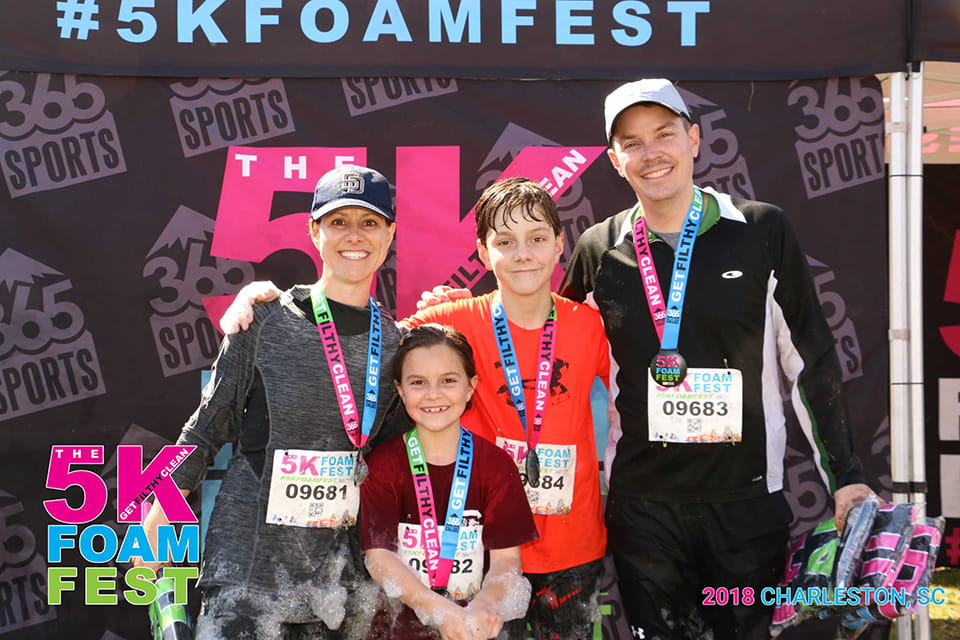 Courtney Nelson (left), seen here with her daughter, Reagan, son, Tanner, and husband Jeff, went from running marathons to not even walking while she was recovering from cancer treatment. Photo provided by Courtney Nelson