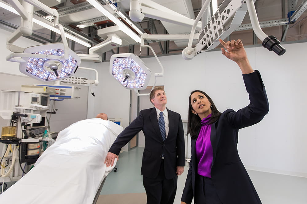 Scott Reeves and Anjali Joseph stand in the mock operating room