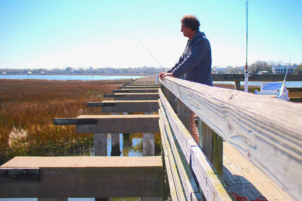 Man fishing on Pitt Street bridge