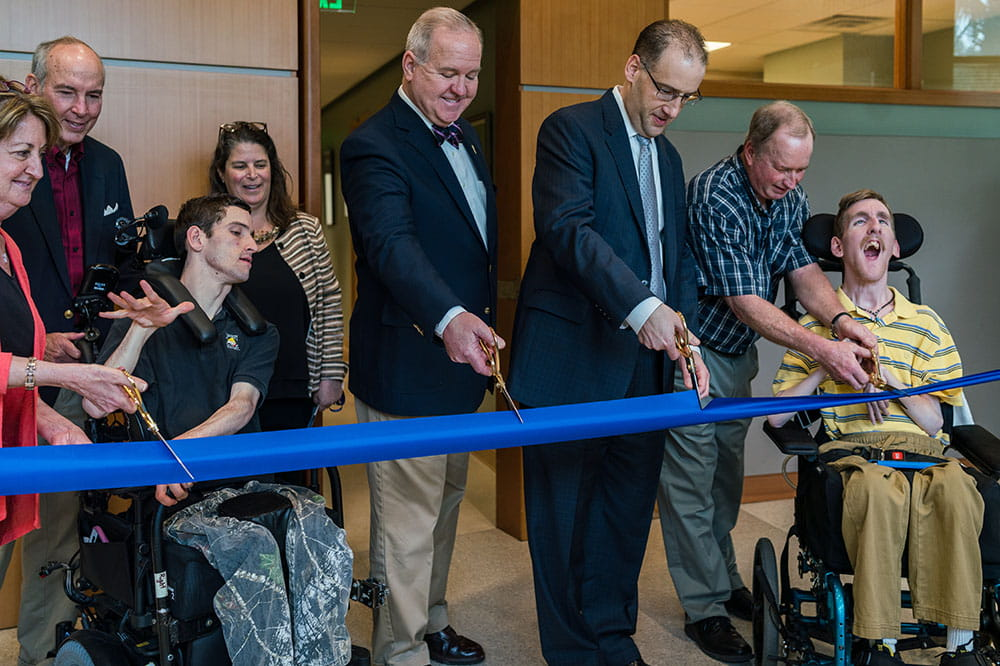 Patients Andrew Stubbs and William Ray are among ribbon cutters at special needs clinic