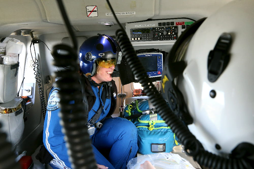 Inside MEDUCARE One as flight nurses give care to a patient.