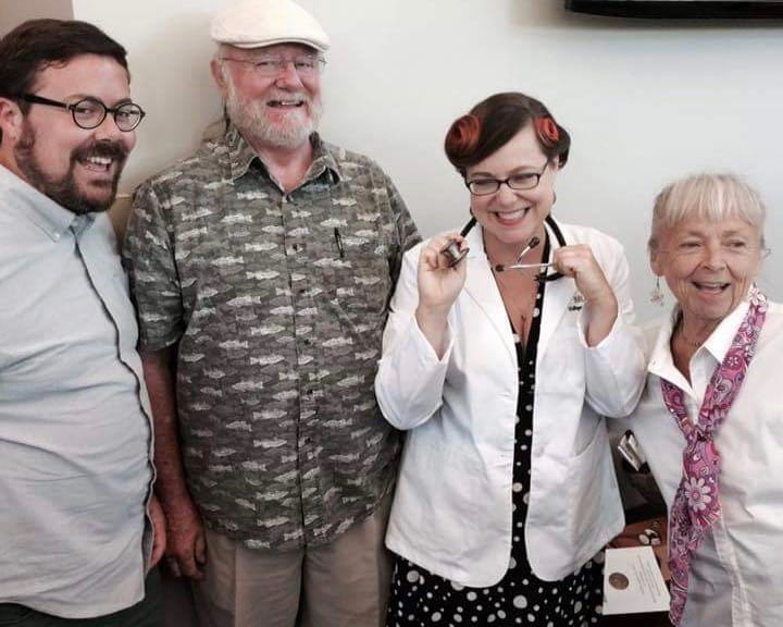 Koci with her parents at her white coat ceremony