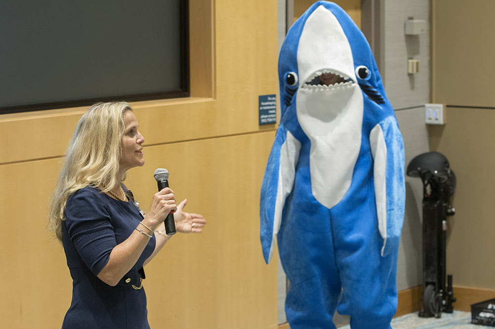 A presenter talks to the sharks about her idea