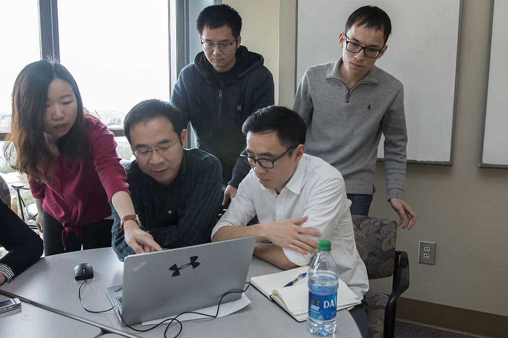 Dr. Changhai Li, second from left, and other Chinese scholars.