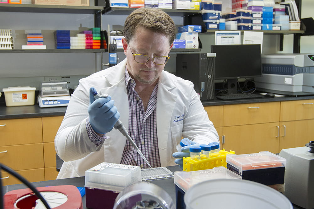 Dr. Eric Daniel Hamlett, lead author of the Glia article, in his laboratory at the Medical University of South Carolina.