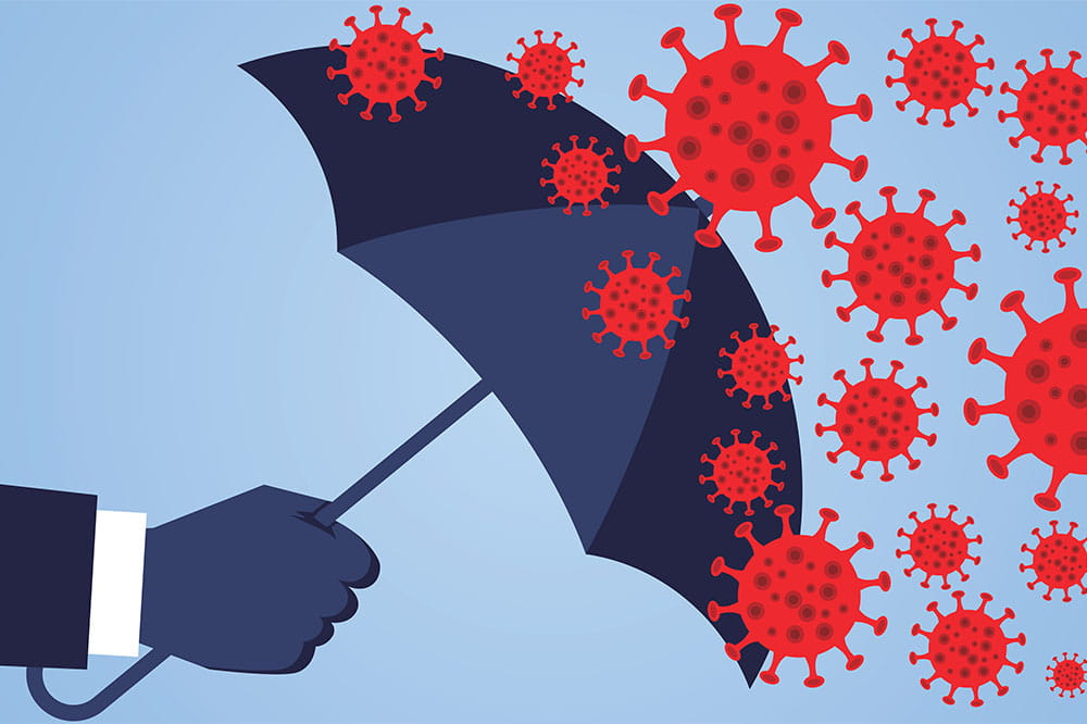 hand holding umbrella against coronavirus