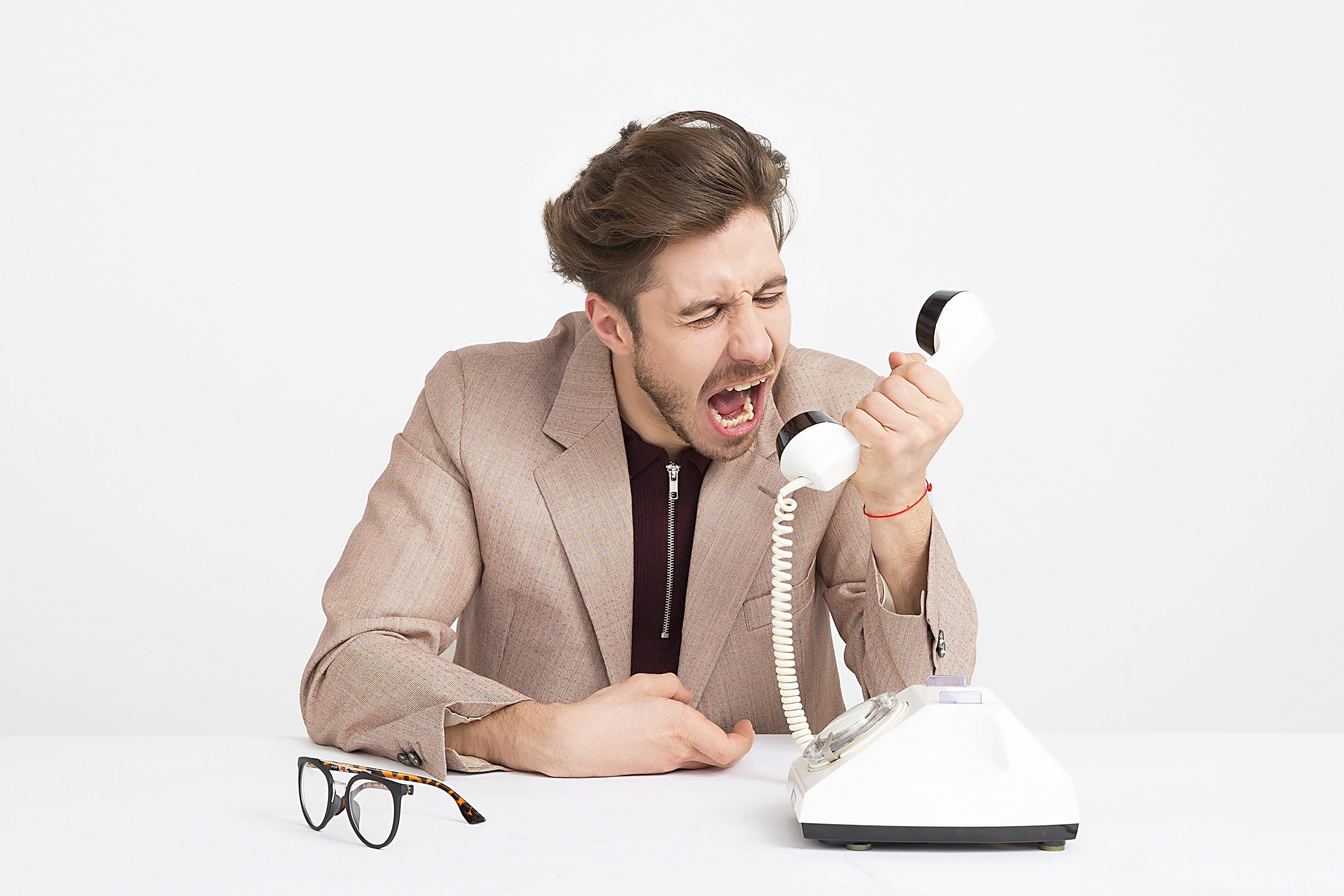 man yelling at phone