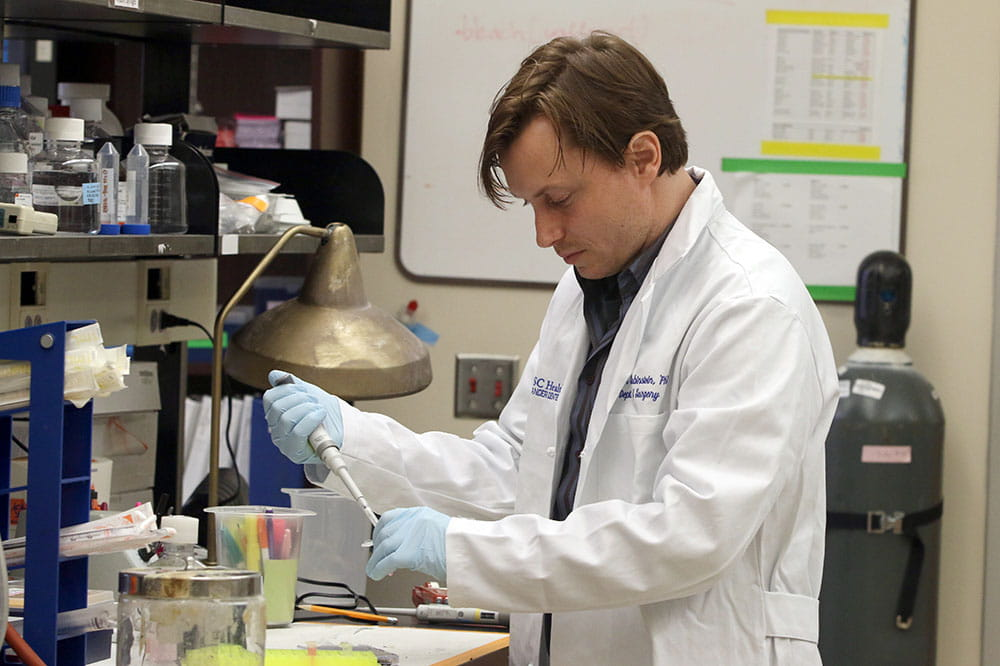 Dr. Mark Rubinstein works in his lab