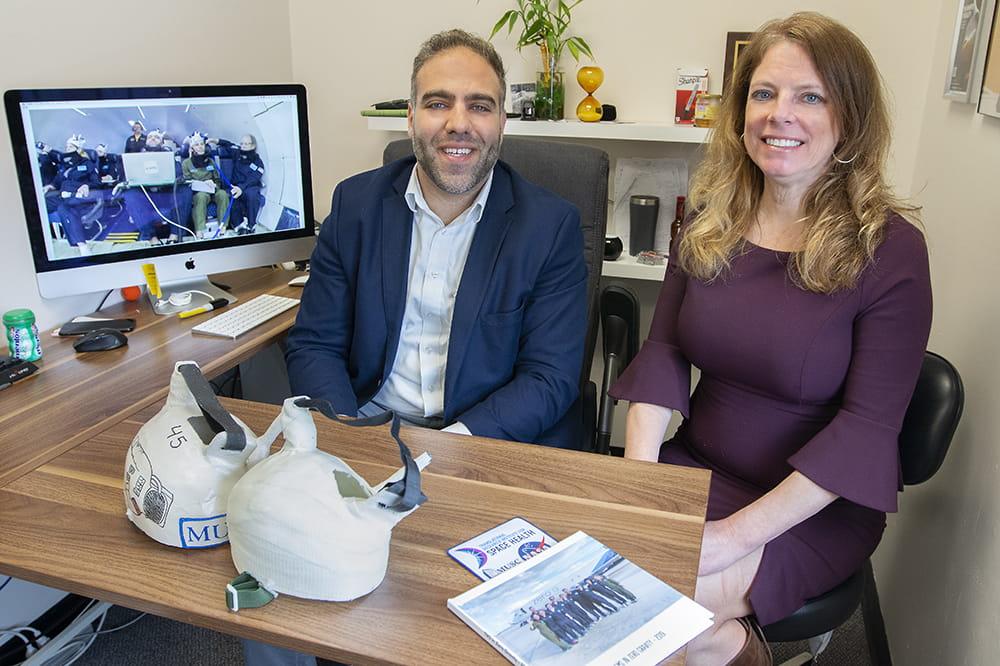 Badran and Roberts sit behind a desk together