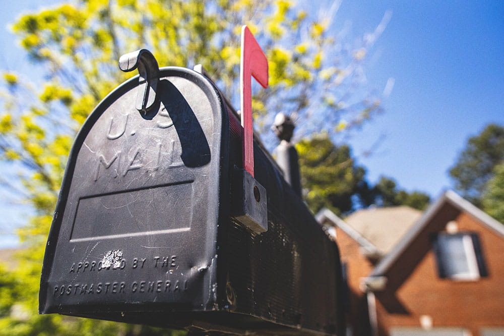 Mailbox in front of brick house