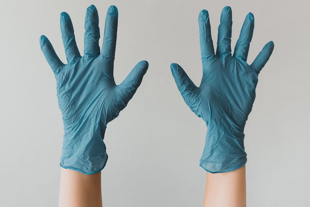 Pair of hands wearing surgical gloves