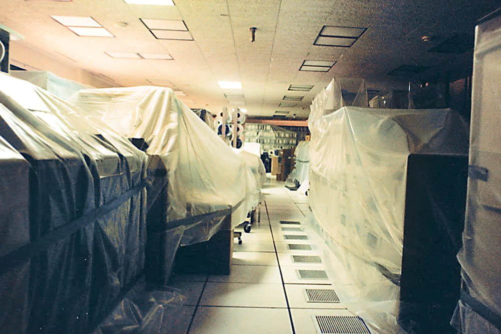 a room filled with oversized computers covered in plastic